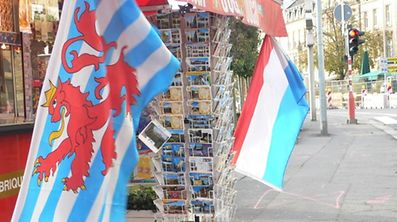 Luxembourg's civil plag, left, and its national flag, right