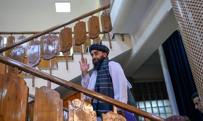 Zabihullah Mujahid, chief spokesman for the Taliban, leaves after addressing a press conference in Kabul on Tuesday