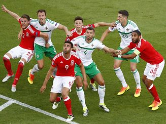 Wales' Ashley Williams, James Chester, Hal Robson-Kanu and Chris Gunter in action with Northern Ireland's Jonny Evans, Gareth McAuley and Craig Cathcart