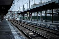 A picture taken in Gare de Lyon railway station in Paris on December 8, 2019 shows an empty platform, during a strike of state railway company SNCF employees over French government's plan to overhaul the country's retirement system, as part of a national general strike. - Trains cancelled, schools closed: France scrambled to make contingency plans on for a huge strike against pension overhauls that poses one of the biggest challenges yet to French President's sweeping reform drive. (Photo by Thomas SAMSON / AFP)