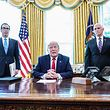 US President Donald Trump meets with US Vice President Mike Pence(R) and US Secretary of Treasury Steven Mnuchin at the White House on June 24, 2019, before signing 'hard-hitting sanctions' on Iran's supreme leader. (Photo by MANDEL NGAN / AFP)