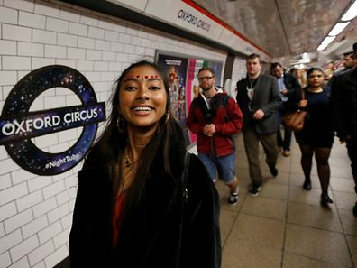 Passengers get off a Night Tube train service at Oxford Circus on the London underground system in London, Britain August 20, 2016. REUTERS/Paul Hackett