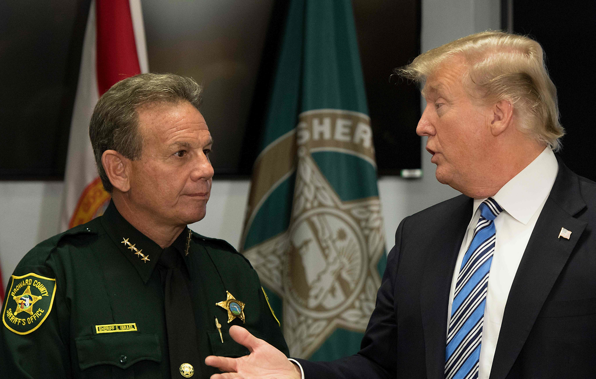 US President Donald Trump speaks with Broward County Sheriff Scott Israel (L) while visiting first responders in Pompano Beach, Florida (AFP)