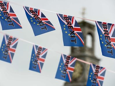 (FILES) This file photo taken on June 13, 2016 shows pro-Brexit flags fly from a fishing boat moored in Ramsgate on June 13, 2016.  The British government is to activate Article 50 to formally begin the process of exiting the European Union on March 29, 2017, Downing Street announced. / AFP PHOTO / CHRIS J RATCLIFFE
