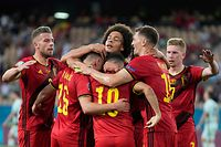 TOPSHOT - Belgium's players celerbate their first goal during the UEFA EURO 2020 round of 16 football match between Belgium and Portugal at La Cartuja Stadium in Seville on June 27, 2021. (Photo by THANASSIS STAVRAKIS / POOL / AFP)