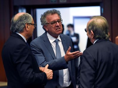 Maltese Finance minister Edward Scicluna (L) talks with Luxembourg's Finance Minister Pierre Gramegna (C) and Italian Minister of Economy and Finance Pier Carlo Padoan (R) during a Eurogroup meeting at the European Union headquarters in Brussels on May 24, 2016.