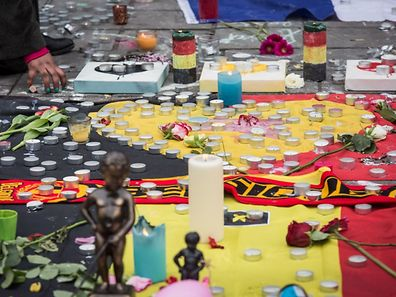 Flowers, candles and other tributes are left on the Place de la Bourse in central Brussels