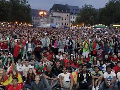 Archive photo shows football fans watching the World Cup final being screened in Place Guillaume II