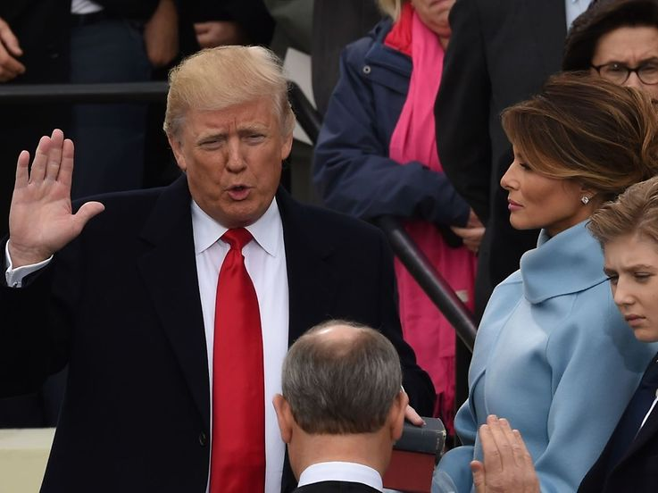 Donald Trump (L) is sworn in as the 45th US president by Supreme Court Chief Justice John Roberts in front of the Capitol in Washington on January 20, 2017.