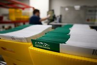 PROVO, UT - OCTOBER 26: Stacks of ballots that need to be opened and counted are seen at the election office on October 26, 2020 in Provo, Utah. Utah is one of several states that has recently moved to mail-in ballots for presidential elections.   George Frey/Getty Images/AFP == FOR NEWSPAPERS, INTERNET, TELCOS & TELEVISION USE ONLY ==