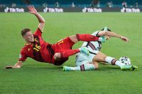 Portugal's defender Diogo Dalot (R) fouls Belgium's midfielder Thorgan Hazard during the UEFA EURO 2020 round of 16 football match between Belgium and Portugal at La Cartuja Stadium in Seville on June 27, 2021. (Photo by THANASSIS STAVRAKIS / POOL / AFP)