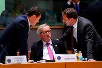 Luxembourg's Prime Minister Xavier Bettel (R) talks to President of the European Commission Jean-Claude Juncker (C) prior to a meeting during an EU summit at the Europa building in Brussels, on June 21, 2019. - European leaders early on June 21, 2019 failed to agree on a new top team to lead efforts to reform their union for 2019-2024, and postponed a decision until the end of June. (Photo by Kenzo TRIBOUILLARD / AFP)