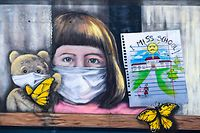 "A graffito depicting a girl and a teddy bear wearing face masks that reads ""I miss school"" is pictured in the town of Ferizaj on June 7, 2020, amid the spread the outbreak of the COVID-19 pandemic, caused by the novel coronavirus. - All schools remain closed in Kosovo since March 14 as part of coronavirus lockdown measures. (Photo by Armend NIMANI / AFP) / RESTRICTED TO EDITORIAL USE - TO ILLUSTRATE THE EVENT AS SPECIFIED IN THE CAPTION"