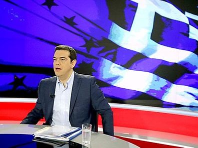 Greek PM Alexis Tsipras prepares for a TV interview