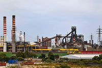 A general view shows the ArcelorMittal Italia steel plant (ex Ilva) on November 7, 2019 in Taranto, southern Italy. - Steel giant ArcelorMittal pulled out of an agreement to buy struggling Italian firm Ilva because of production concerns, Italy's prime minister has said, warning the company wants to cut 5,000 jobs at one of its plants. The world's biggest steelmaker on November 4, 2019 retreated from its plan to buy the steel producer, blaming a decision by Rome to not grant it immunity from prosecution over the heavily polluting Taranto plant. (Photo by Andreas SOLARO / AFP)