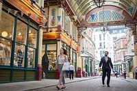 People walks past shops and restaurants at Leadenhall Market in the City of London on July 27, 2021. - Prime Minister Boris Johnson called for caution Tuesday after Britain registered nearly a week of lower coronavirus case numbers, a decline that has surprised officials and experts. (Photo by Tolga Akmen / AFP)