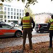 CORRECTION - German policemen stand guard near Rosenheimer square after a man attacked passersby on October 21, 2017 in the southern German city of Munich. The man attacked passersby in five places near Rosenheimer Platz in the eastern part of the city centre at around 0630 GMT, inflicting light injuries on four people, a police spokesman told AFP. The perpetrator, described by the police as a man in his forties, wearing grey pants and a running jacket, fled the scene on a black bicycle. / AFP PHOTO / DPA / Andreas Gebert / Germany OUT / �The erroneous mention[s] appearing in the metadata of this photo by Andreas Gebert has been modified in AFP systems in the following manner: [source DPA-GERMANY OUT] instead of [source AFP]. Please immediately remove the erroneous mention[s] from all your online services and delete it (them) from your servers. If you have been authorized by AFP to distribute it (them) to third parties, please ensure that the same actions are carried out by them. Failure to promptly comply with these instructions will entail liability on your part for any continued or post notification usage. Therefore we thank you very much for all your attention and prompt action. We are sorry for the inconvenience this notification may cause and remain at your disposal for any further information you may require.�