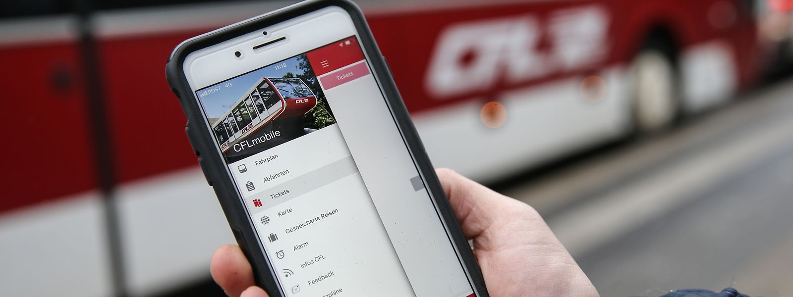 IPO Illustration Gratis öffentlicher Transport, Mobilität, Bus,Zug Ticket,App, Fahrschein. Foto: Gerry Huberty/Luxemburger Wort
