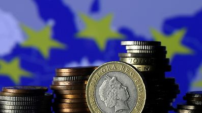 FILE PHOTO: Pound coins are seen in front of a displayed EU flag in this picture illustration taken January 18, 2017.  REUTERS/Dado Ruvic/Illustration