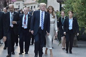 US President Donald Trump and US First Lady Melania Trump arrive for a concert of La Scala Philharmonic Orchestra at the ancient Greek Theatre of Taormina during the Heads of State and of Government G7 summit, on May 26, 2017 in Sicily. / AFP PHOTO / TIZIANA FABI