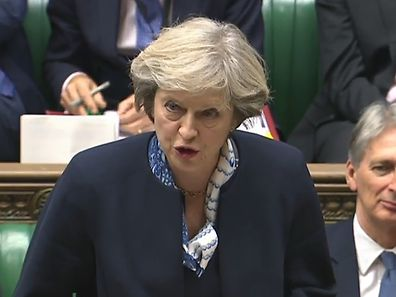 """A video grab from footage broadcast by the UK Parliament's Parliamentary Recording Unit (PRU) shows British Prime Minister Theresa May as she speaks during Prime Minister's Questions (PMQs) in the House of Commons in London on October 12, 2016. British Prime Minister Theresa May signalled ahead of a House of Commons debate on October 12, that she would let parliament scrutinise her plan for Brexit before she begins the formal process to exit the European Union (EU). / AFP PHOTO / PRU AND AFP PHOTO / HO / RESTRICTED TO EDITORIAL USE - MANDATORY CREDIT """" AFP PHOTO / PRU """" - NO MARKETING NO ADVERTISING CAMPAIGNS - NO RESALE - NO DISTRIBUTION TO THIRD PARTIES - 24 HOURS USE - NO ARCHIVES"""
