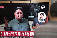 A man watches a television news showing a file footage of North Korean leader Kim Jong Un, at a railway station in Seoul on July 25, 2019. - North Korea fired two short-range missiles into the sea on July 25, South Korea's Joint Chiefs of Staff said, after warnings from Pyongyang over military exercises between Washington and Seoul next month. (Photo by Jung Yeon-je / AFP)