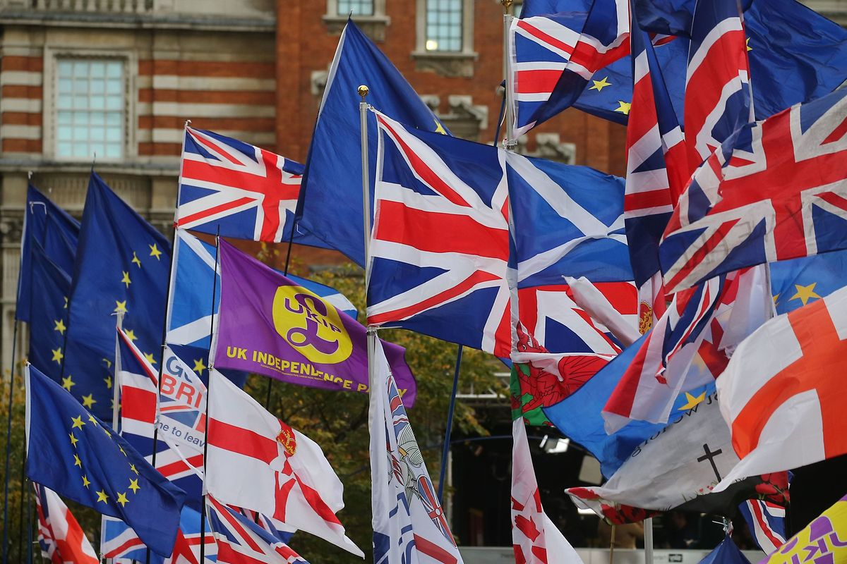 Flags fly outside the Houses of Parliament in London on 29 October Photo: AFP