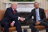 (FILES) In this file photo US President Barack Obama and President-elect Donald Trump shake hands during a  transition planning meeting in the Oval Office at the White House in Washington, DC. - President Donald Trump broke with tradition on May 14 by calling for investigation of his White House predecessor Barack Obama in the latest attempt to push a conspiracy theory about his Democratic opponents. (Photo by JIM WATSON / AFP)