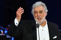"""(FILES) In this file photo taken on August 28, 2019 Spanish tenor Placido Domingo performs during his concert in the newly inaugurated sports and culture centre 'St Gellert Forum' in Szeged, southern Hungary. - Domingo, the legendary opera singer facing myriad sexual harassment accusations, is withdrawing from all future performances at New York's Metropolitan Opera, both he and the institution announced on September 24, 2019. The 11th-hour decision comes just one night before the 78-year-old Spaniard dubbed the """"king of opera,"""" who denies all allegations, was scheduled to perform in the Met's production of """"Macbeth."""" (Photo by Attila KISBENEDEK / AFP)"""