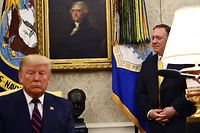 US Secretary of State Mike Pompeo (L) attends a meeting between President Donald Trump and Italian President Sergio Mattarella (not pictured) in the Oval Office of  the White House in Washington, DC, on October 16, 2019. (Photo by Brendan Smialowski / AFP)