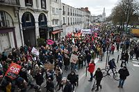 People take part in a demonstration during a nation-wide action day of French civil servants against French government's string of reforms on March 22, 2018  in Nantes, western France. Seven trade unions have called on public sector workers to strike on March 22, including school and hospital staff, civil servants and air traffic controllers. More than 140 protests are planned across France, the biggest culminating at the Bastille monument in Paris where unions expect 25,000 demonstrators.  / AFP PHOTO / JEAN-SEBASTIEN EVRARD