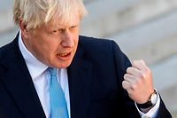 (FILES) In this file photo taken on August 28, 2019 Britain's Prime Minister Boris Johnson speaks to the press ahead of a meeting at The Elysee Palace in Paris, with French President Emmanuel Macron. - Since coming to power in July, Boris Johnson has shed his image as a jovial, wisecracking mophead to reveal a ruthless streak that has marked him out since childhood. (Photo by GEOFFROY VAN DER HASSELT / AFP)