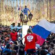Russia's fans celebrate in central Moscow after Russia won the Russia 2018 World Cup round of 16 football match against Spain on July 1, 2018. / AFP PHOTO / Konstantin CHALABOV