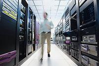 Man working in data center Cyber data server