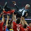 (FILES) This file photo taken on May 26, 2013 shows then Bayern Munich's German Head Coach Jupp Heynckes being thrown in the air by Bayern players after their victory in the UEFA Champions League final football match between Borussia Dortmund and Bayern Munich at Wembley Stadium in London. German sports magazine Sport Bild reports on October 5, 2017 that Heynckes will succeed Bayern's sacked Italian coach Carlo Ancelotti until the end of the season. / AFP PHOTO / PATRIK STOLLARZ