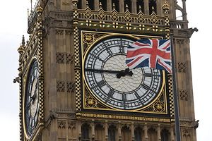 A Union flag is seen flapping in the wind in front of one of the faces of the Great Clock atop the landmark Elizabeth Tower that houses Big Ben at the Houses of Parliament in London on June 27, 2016. Top Brexit campaigner Boris Johnson sought Monday to build bridges with Europe and with defeated Britons who voted to remain in the EU in last week's historic referendum. London stocks sank more than 0.8 percent in opening deals on Monday, despite attempts by finance minister George Osborne to calm jitters after last week's shock Brexit vote. / AFP PHOTO / JUSTIN TALLIS
