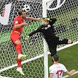 England's forward Harry Kane (L) vies for the ball with Tunisia's goalkeeper Mouez Hassen (R) during the Russia 2018 World Cup Group G football match between Tunisia and England at the Volgograd Arena in Volgograd on June 18, 2018. / AFP PHOTO / Nicolas ASFOURI / RESTRICTED TO EDITORIAL USE - NO MOBILE PUSH ALERTS/DOWNLOADS