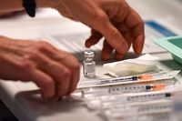 A nurse fills a syringe with the Pfizer-BioNtech coronavirus disease (Covid-19) vaccine on January 4, 2020 in the Bellevue gerontology center in Montpellier in the south of France. - French president faced on January 4, 2020 growing pressure to accelerate France's Covid-19 vaccination drive which has seen just a few hundred people receive the jab. (Photo by Pascal GUYOT / AFP)