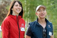 (FILES) In this file photo taken on July 10, 2013, Jeff Bezos, founder and CEO Amazon.com, and his wife Mackenzie Bezos arrive for morning session of the Allen & Co. annual conference at the Sun Valley Resort in Sun Valley, Idaho. - MacKenzie Bezos announced on April 4, 2019, the couple had finalized their divorce, and that she would surrender 75 percent of the couple's shares in the tech giant. Bezos also said she would surrender all of her stake in The Washington Post and the space exploration firm Blue Origin to her ex-husband, as well as voting control of her remaining Amazon shares. (Photo by KEVORK DJANSEZIAN / GETTY IMAGES NORTH AMERICA / AFP)