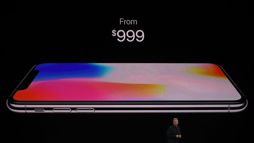 Apple senior vice president of worldwide marketing Phil Schiller introduces the new iPhone X during an Apple special event at the Steve Jobs Theatre on the Apple Park campus on September 12, 2017 in Cupertino, California