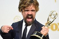 TOPSHOTS Peter Dinklage arrives in the Press Room with his award for Best Supporting Actor in a Drama at the 67th Emmy Awards on September 20, 2015 at the Microsoft Theater in Los Angeles, California. AFP PHOTO / VALERIE MACON