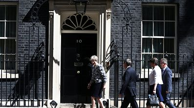 Britain's Prime Minister, Theresa May, leads Democratic Unionist Party Leader Arlene Foster, Deputy Leader Nigel Dodds, and Chief Whip Jeffrey Donaldson, into 10 Downing Street.