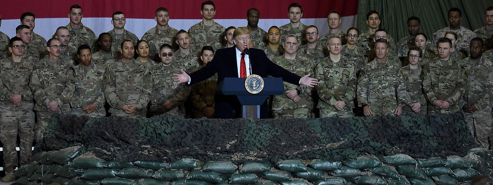 US President Donald Trump speaks to the troops during a surprise Thanksgiving day visit at Bagram Air Field, on November 28, 2019 in Afghanistan. (Photo by Olivier Douliery / AFP)