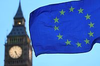 """(FILES) In this file photo taken on February 20, 2017 A European Union flag flies near the Elizabeth Tower, otherwise known as Big Ben, as an anti-Trump protest gets underway in London. - The EU and Britain agreed on November 22, 2018, a draft declaration on their post-Brexit relations that sets out an """"ambitious, broad, deep and flexible partnership,"""" officials said. European Council President Donald Tusk said the EU executive informed him it has agreed the political declaration on the future relationship with Britain. (Photo by Justin TALLIS / AFP)"""
