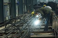 An employee works on steel bars at a factory in Hangzhou, in China's eaastern Zhejiang province on May 15, 2020. - China's industrial output returned to growth for the first time this year in April, official data showed on May 15, but another sharp drop in retail sales indicated crucial consumer demand remains weak, which could scotch hopes for a quick economic recovery. (Photo by STR / AFP) / China OUT