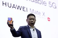 Richard Yu, the CEO of Huawei's consumer products division presents the new HUAWEI Mate X foldable smartphone at the Mobile World Congress (MWC), on the eve of the world's biggest mobile fair, on February 24, 2019 in Barcelona. - Phone makers will focus on foldable screens and the introduction of blazing fast 5G wireless networks at the world's biggest mobile fair starting tomorrow in Spain as they try to reverse a decline in sales of smartphones. (Photo by Josep LAGO / AFP)