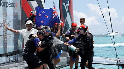 Sailing - America's Cup finals - Hamilton, Bermuda - June 26, 2017 -  Peter Burling, Emirates Team New Zealand Helmsman celebrates as he sprays teammates after defeating Oracle Team USA in race nine to win the America's Cup. REUTERS/Mike Segar