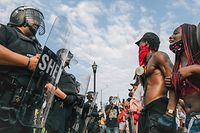 KENOSHA, WI - AUGUST 24: Demonstrators participate in a form a line in front of law enforcement on August 24, 2020 in Kenosha, Wisconsin. A night of civil unrest occurred after the shooting of Jacob Blake, 29, on August 23. Blake was shot multiple times in the back by Wisconsin police officers after attempting to enter into the drivers side of a vehicle.  (Photo by Brandon Bell/Getty Images)