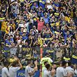 Fans of Argentina's Boca Juniors attend a training session of the team at the La Bombonera stadium in Buenos Aires on November 22, 2018, ahead of the Copa Libertadores final against River Plate to be held on November 24. (Photo by Juan MABROMATA / AFP)