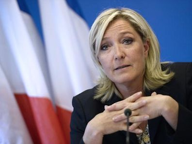 Marine Le Pen speaking at a press conference at the FN headquarters in Nanterre, near Paris, in this June 25, 2014, file photo